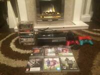 PS3 CONSOLE WITH 25 GAMES AND 4 CONTROLLERS