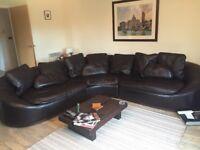 Large 6/7 seater Giovanni Sforza medium brown leather corner sofa.