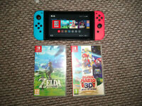 Nintendo switch in excellent condition with two games