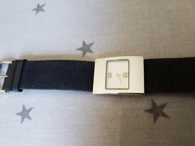 Gucci Ladies stainless steel watch, black fabric strap.