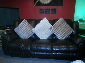 3 peice leather suite with recliners .