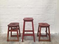 Vintage industrial retro solid wood red stools.