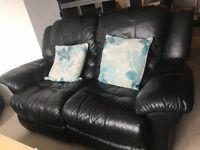 Black leather 2/3 seater, armchair, stamorage footstool