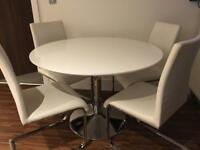 Lovely white round gloss table with 4 chairs