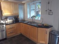 Large kitchen. Shaker style with variety of cupboards, drawers, and larder unit. Sink & tap.