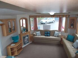 Luxury heated caravan Devon nr Cornwall open all year by the sea includes site fees