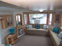 Luxury heated caravan Devon nr Cornwall open all year by the sea includes site fees