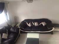 Black and cream sofa 3+3 seater with coffee table
