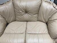 Two seater cream leather sofa