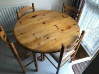 DROP LEAF SOLID PINE TABLE AND 4 DINING CHAIRS. CAN DELIVER