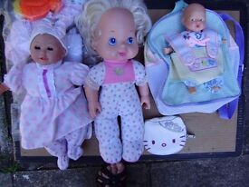 Collection of dolls, battery operated tiger toy and soft toys with a storage bag