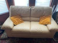 Cream leather sofa and arm chair