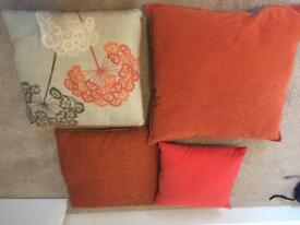 Orange pillows and blanket