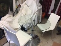 glass top table with 2 white leather chairs