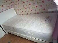 White and pink wooden single bed