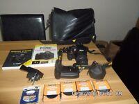 nikon3200+bundle 2books,batter grip 32gb card nd filters