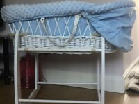 Blue wicker Moses basket