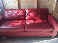 Red 2 seater leather sofa good clean condition