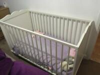 Small white cot crib