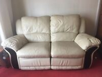 Cream Leather Sofa, with adjustable foot rest.