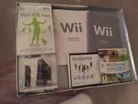 Nintendo Wii with Controllers, Numchuck, Wii Fit Board, Wii Sport and Games