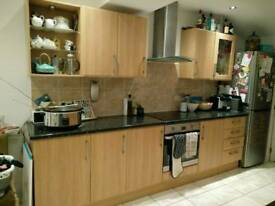 Full set of wood effect Howdens kitchen cupboard doors