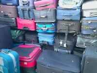 THREE LARGE UPRIGHT SUITCASES - USED - COLLECT FROM RADLETT HERTS