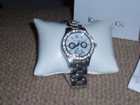 Karine & Co. ladies watch with sparkles around the face(needs a battery)