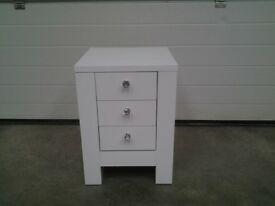 New White gloss 3 drawer bedside cabinet with crystal handles. 1 TINY nick. Bargain.