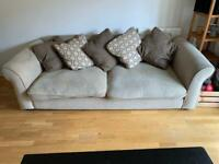Four seater pillow back sofa