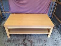 Large solid light wood coffee table with shelf underneath
