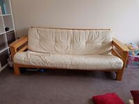 3 seater wooden futon. Sold with mattress. Very solid.