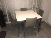 White high gloss table with 4 mocha leather chairs (includes placemats & coasters)