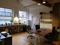 Four desks in trendy media office in Shoreditch