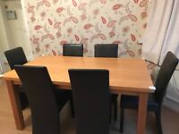 Oak dining table and 6 Brown Faux Leather chairs