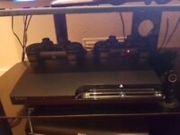 Ps3 120gb slim 23 game's 2 controllers and ps3 earpiece