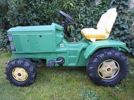 Two John Deere Ride on toy tractors.