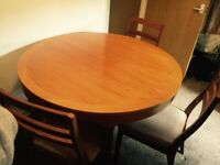 Lovely solid wood extending dining table and 6 chairs well looked after msg for more info !