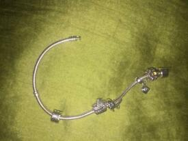 Genuine pandora bracelet and 5 charms