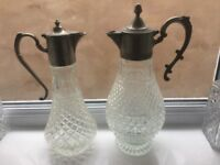 Glass wine decanters - two claret jugs