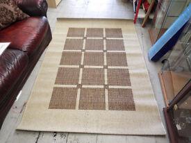 Beige and brown rug