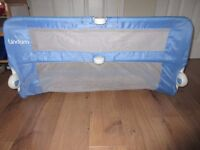 Blue and white Lindam bed guard.