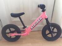 Pink strider balance bike