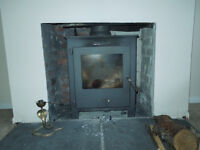 Gray stove company woodburner and liner and top hat and plates