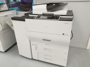 HIGH PERFORMANCE MULTIFUNCTIONAL RICOH MP C6502 COPIER SCANNER PRINTER  WITH PRINTING SPEED UP TO 65PPM.