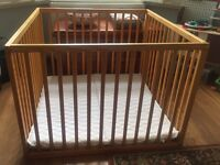 Wooden play pen with mattress