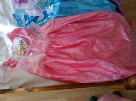 SET OF 4 DISNEY PRINCESS DRESSES. AGED 8-9