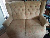 Two seater sofa. As new. High backed. Bought one year ago.