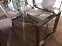 Contemporary glass table and six white faux leather chairs