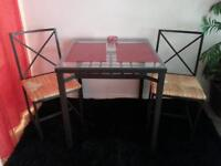 three piece dining set glass and metal wth wicker chairs . like